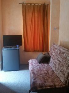 Телевизор и/или развлекательный центр в Мини-отель Крафт
