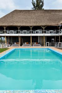 Het zwembad bij of vlak bij Pili Pili Boutique Hotel