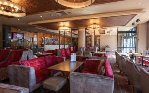 A restaurant or other place to eat at City Hotel