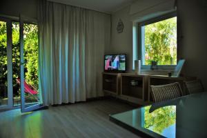 Telewizja i/lub zestaw kina domowego w obiekcie Pucka Bryza Holiday Home