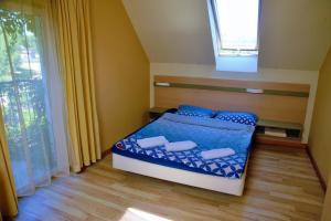 Łóżko lub łóżka w pokoju w obiekcie Pucka Bryza Holiday Home