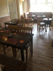 A restaurant or other place to eat at Novar Arms Hotel