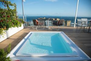 The swimming pool at or near Grand Hotel Vesuvio