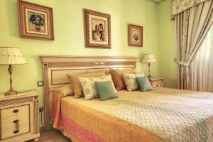 Ein Bett oder Betten in einem Zimmer der Unterkunft Hotel La Colina
