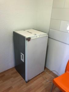 A kitchen or kitchenette at Zimmervermittlung