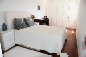 A bed or beds in a room at A House with a View