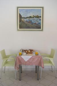 Restaurant ou autre lieu de restauration dans l'établissement Trianta Hotel Apartments