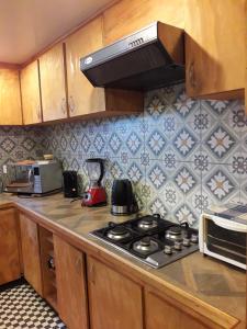 A kitchen or kitchenette at La casa del Kori