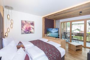 Ein Bett oder Betten in einem Zimmer der Unterkunft Wagner's Aparthotel