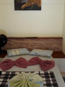 A bed or beds in a room at Pousada do Horto