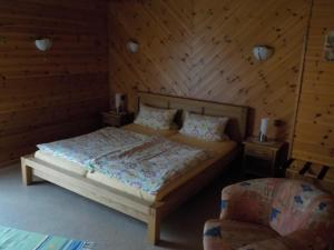 A bed or beds in a room at Landhaus Wartenstein
