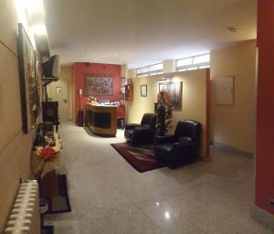 El vestíbulo o zona de recepción de Hostal Guzmán El Bueno