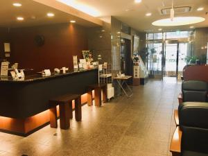 A restaurant or other place to eat at Hotel Route-Inn Fukaya Ekimae