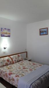 Łóżko lub łóżka w pokoju w obiekcie Frontera Primavera