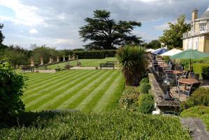 A garden outside Best Western Chilworth Manor Hotel