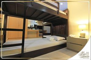 Кровать или кровати в номере BSA Twin Towers