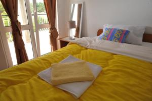 A bed or beds in a room at Apartments Sea Star