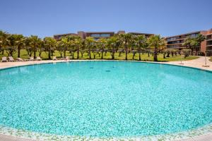 The swimming pool at or near the Quest - Luxury Beach Apartment