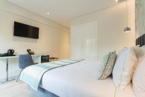 Een bed of bedden in een kamer bij Hotel Capital