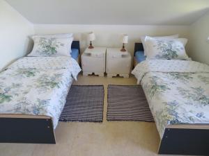 Łóżko lub łóżka w pokoju w obiekcie Agrocamp