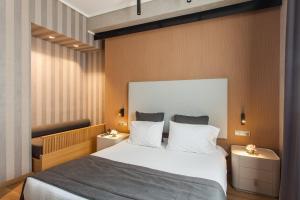 Ein Bett oder Betten in einem Zimmer der Unterkunft Egnatia Palace Hotel & Spa