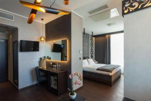 Телевизор и/или развлекательный центр в Egnatia Palace Hotel & Spa
