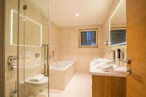 Ein Badezimmer in der Unterkunft Hotel dasMEI