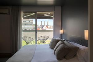 מיטה או מיטות בחדר ב-Sixties Ramblas
