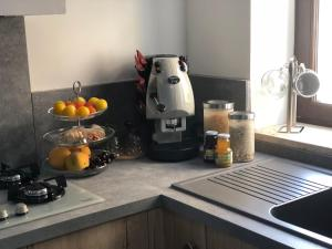 A kitchen or kitchenette at B&b Slow life