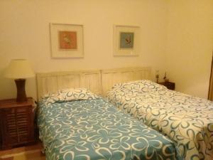 A bed or beds in a room at Casa das Andorinhas