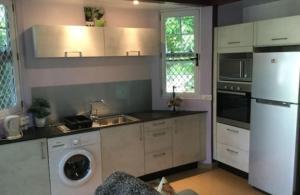A cozinha ou cozinha compacta de Bungalow Heipoe
