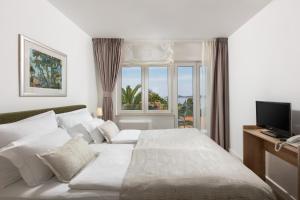 Een bed of bedden in een kamer bij Aparthotel Pharia