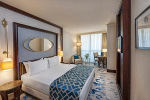 A bed or beds in a room at Elite World Istanbul Hotel