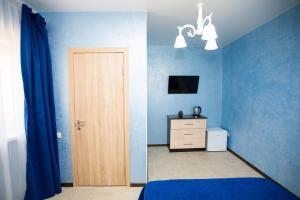 Телевизор и/или развлекательный центр в Hotel ZET