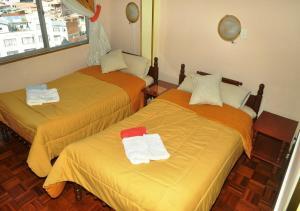 Кровать или кровати в номере Hotel Milton