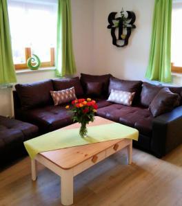 Ein Sitzbereich in der Unterkunft Alpenliebe Ferienwohnungen