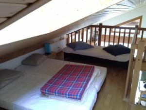 A bed or beds in a room at Cordon Balcon Du Mont Blanc