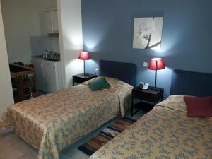 A bed or beds in a room at Apartment Hotel Athina