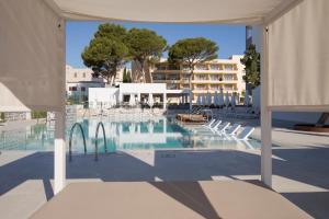 Piscina en o cerca de Hotel Bella Playa & Spa