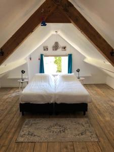 Een bed of bedden in een kamer bij Hogezoom 133