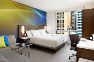 A bed or beds in a room at LUMA Hotel - Times Square
