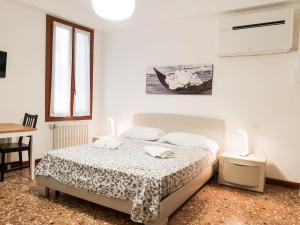 Cama ou camas em um quarto em Ca Loredan