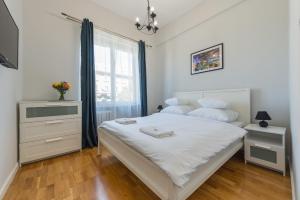 Łóżko lub łóżka w pokoju w obiekcie P&O Apartments Andersa INTRACO
