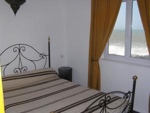 Кровать или кровати в номере Dar Al Bahar