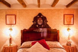 Llit o llits en una habitació de Cal Calaf