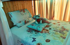 Cama o camas de una habitación en Apartamentos Los Delfines