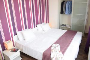 Cama o camas de una habitación en Corvin Center Suites