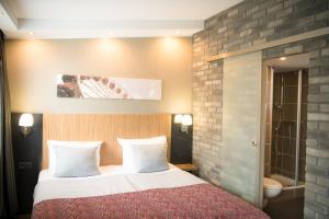 Ein Bett oder Betten in einem Zimmer der Unterkunft Hotel Munich City