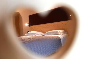 A bed or beds in a room at Albergo Sporting