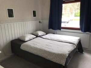 Кровать или кровати в номере Guesthouse Borealis